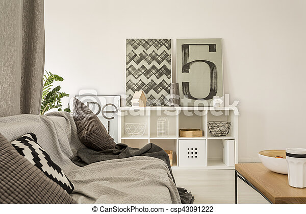 Living room with sofa and coffee table - csp43091222