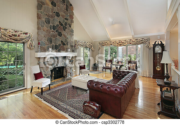 Living room with stone fireplace - csp3302778
