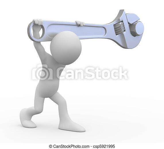 Un hombre con una enorme llave ajustable - csp5921995