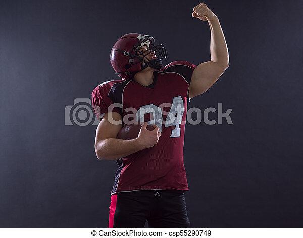 Jugador de fútbol americano celebrando el touchdown - csp55290749