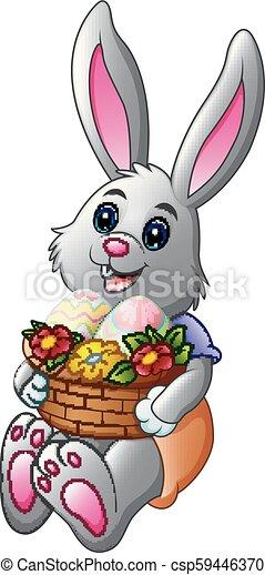 Un conejito de Pascua con una cesta llena de huevos - csp59446370
