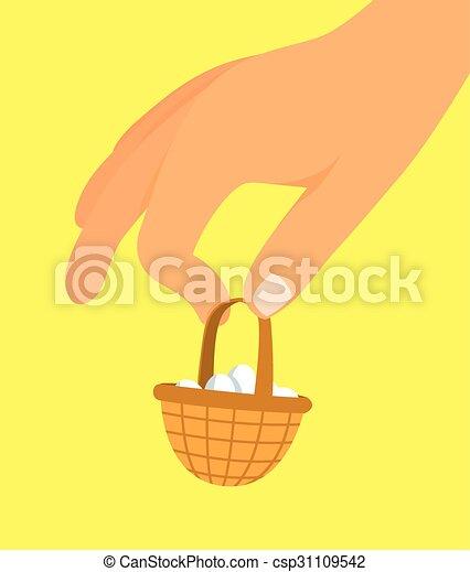 Mano sosteniendo una pequeña canasta de picnic llena de huevos - csp31109542