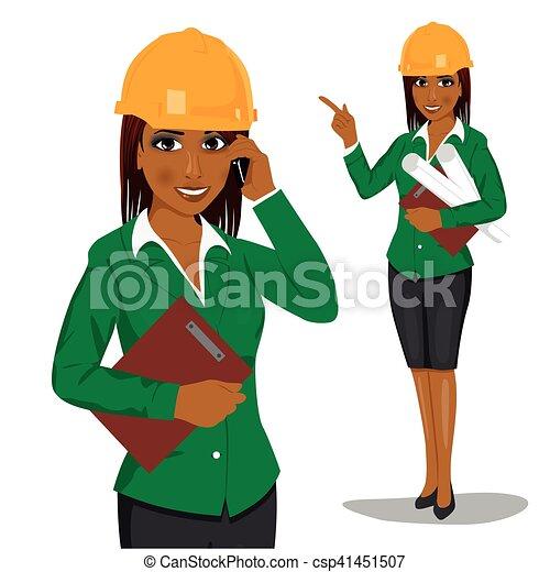 Arquitecta afroamericana con cascos de seguridad amarillos con planos y portapapeles hablando por teléfono - csp41451507