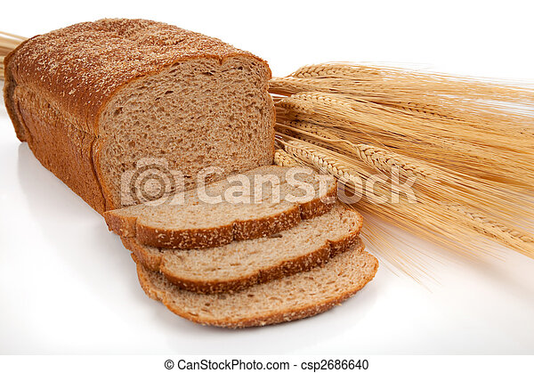 Loaf of wheat bread and shocks of wheat - csp2686640