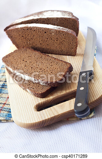 Loaf of wholegrain bread cut on slices - csp40171289