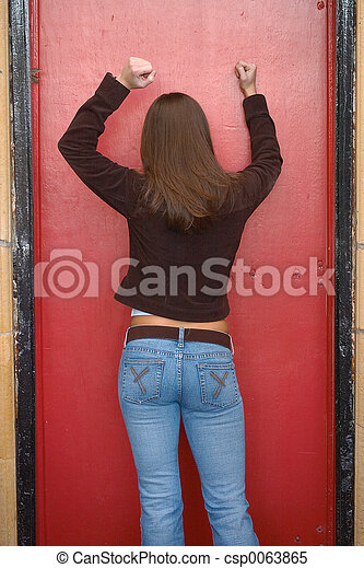 Locked Out Young Woman Knocking On Red Door Trying To Get