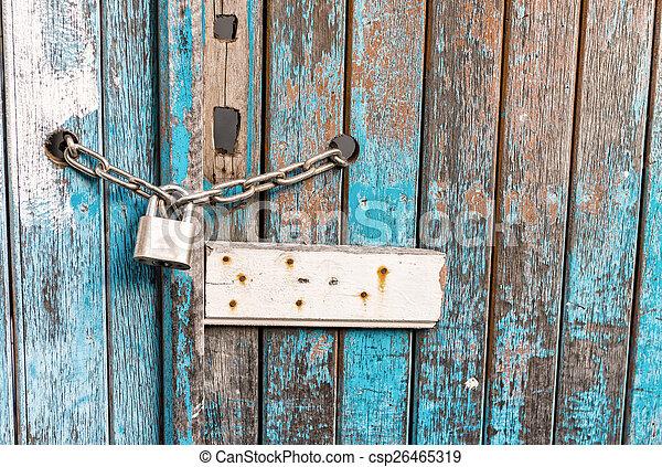 Locker on a vintage old wooden door - csp26465319