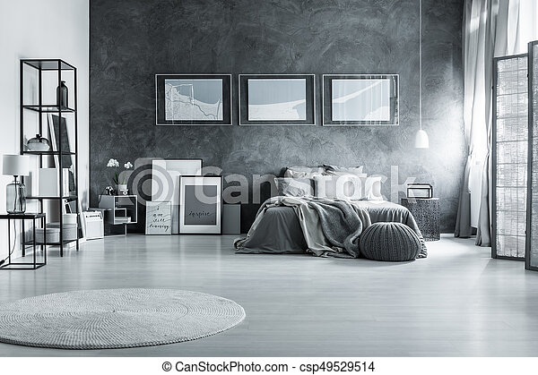 Loft gray bedroom with posters