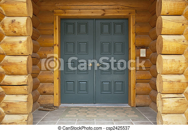 Log home front door detail. Close up view of a log cabin ...