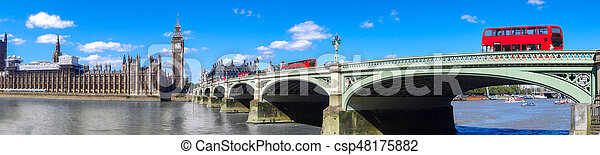 London panorama with red buses on bridge against Big Ben in England, UK - csp48175882