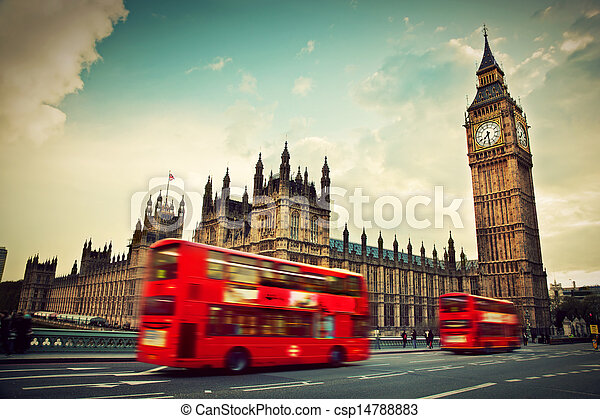 London, the UK. Red bus in motion and Big Ben - csp14788883