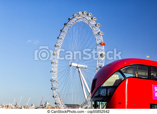 LONDON, UK - JANUARY 2, 2015: The London Eye and iconic red bus. London Eye (135 m tall, diameter of 120 m), a famous tourist attraction over river Thames - csp55852542