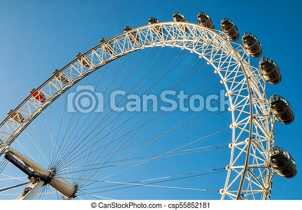 LONDON, UK - JANUARY 2, 2015: View of the London Eye. London Eye (135 m tall, diameter of 120 m) - a famous tourist attraction over river Thames - csp55852181