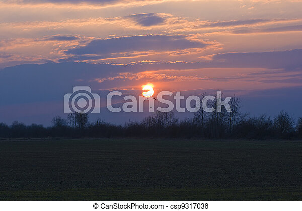 Lone paraglider and sunset - csp9317038