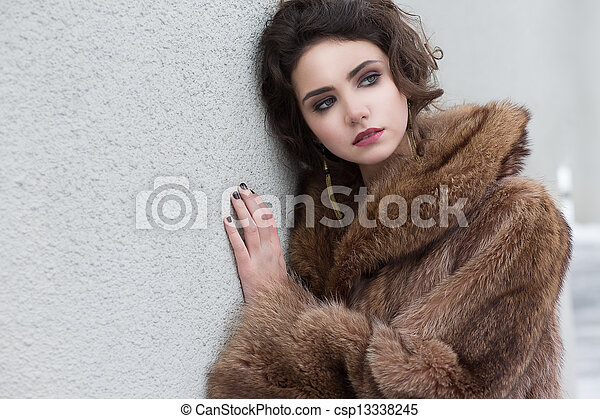 Loneliness. Winter. Beautiful Refined Female in Wool Fur Coat - csp13338245