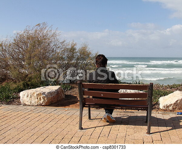 Loneliness.Woman sitting alone on   - csp8301733