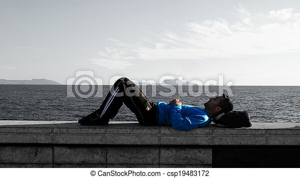 lonely boy lying waterfront - csp19483172