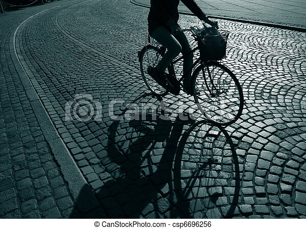 Lonely feamale cyclist - csp6696256