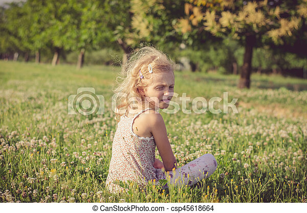 lonely girl in green spring meadow - csp45618664