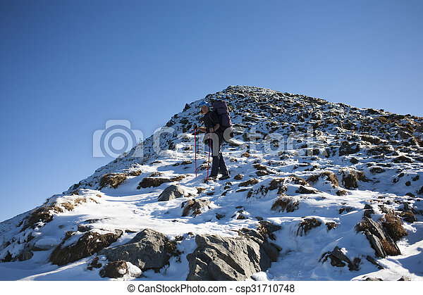 Lonely girl travels through mountains. - csp31710748