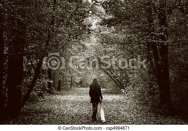 Lonely sad woman on the wood road - csp4994671