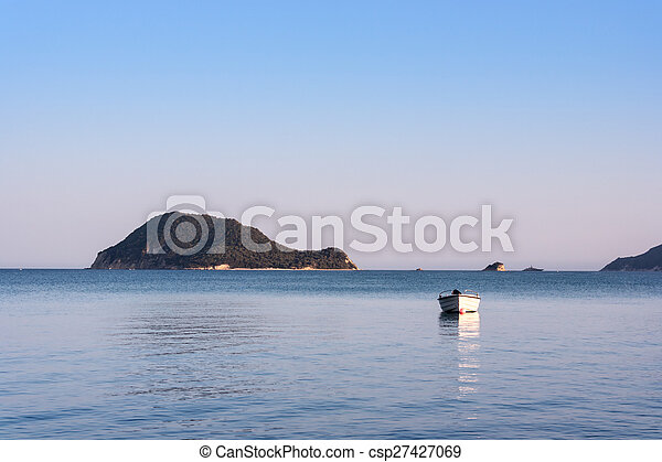 Lonely traditional greek fishing boat on sea water - csp27427069