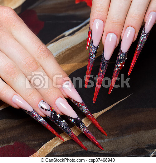 Long Beautiful Manicure On The Fingers In Black And Red Colors With