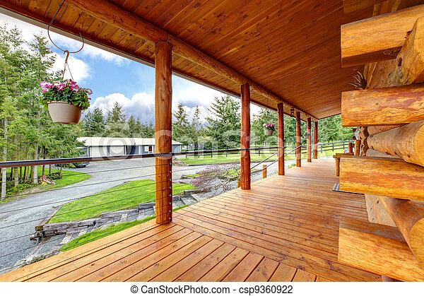 Long cabin horse farm house porch. - csp9360922