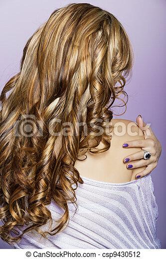 long curly blond hair - csp9430512