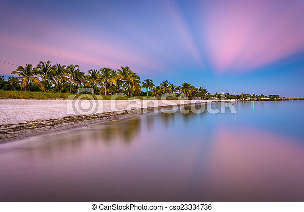 Long exposure at sunset of Smathers Beach, Key West, Florida. - csp23334736