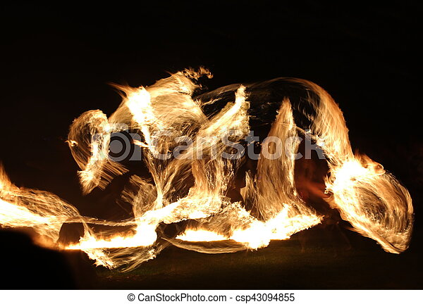Long exposure shot of moving burning torches and fire - csp43094855