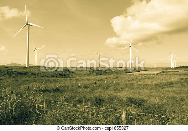 long grass and bogland with wind turbines in sepia - csp16553271