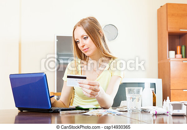 long-haired woman buying drugs online with laptop - csp14930365