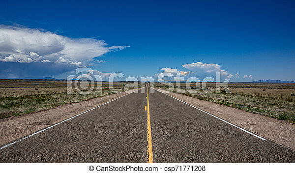 Long highway in the american desert, blue sky with clouds - csp71771208