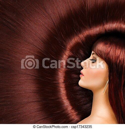 Long red shiny hair of a beautiful girl - csp17343235