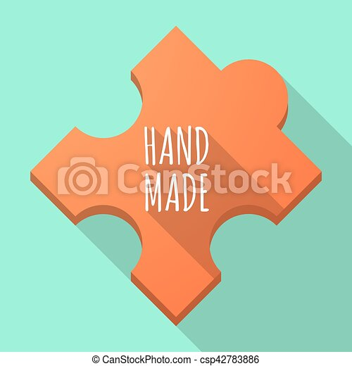Long shadow puzzle piece with the text HAND MADE - csp42783886