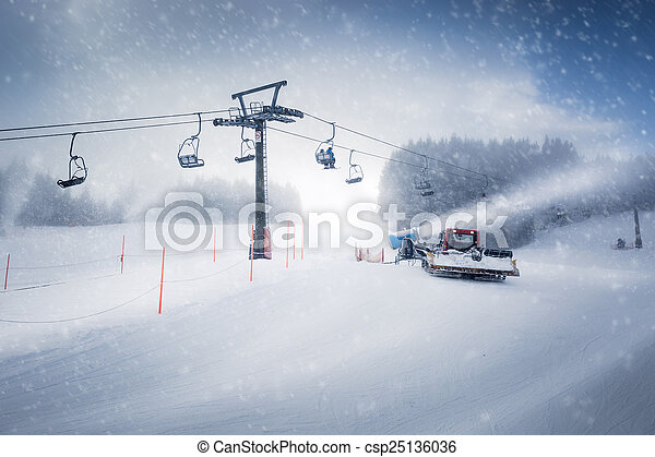 long ski lift line and the working snow cannon on Austrian Alps - csp25136036