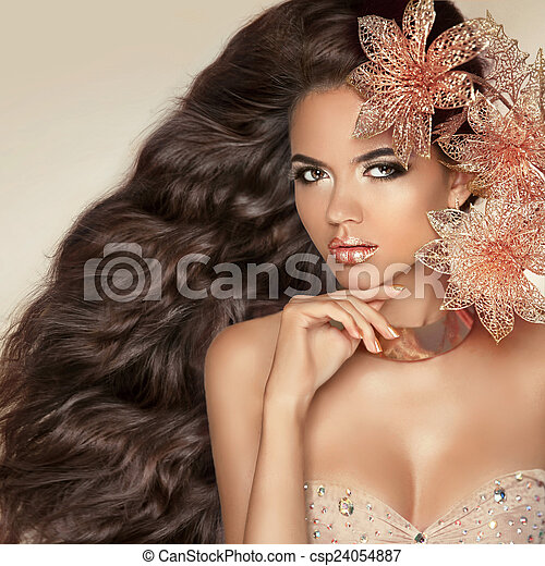 Long wavy hair. Beautiful Attractive brunette Girl With Flowers. - csp24054887