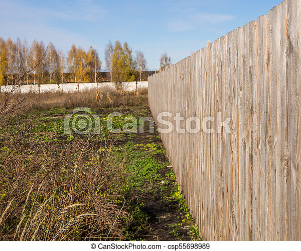 Long wooden fence on the field - csp55698989