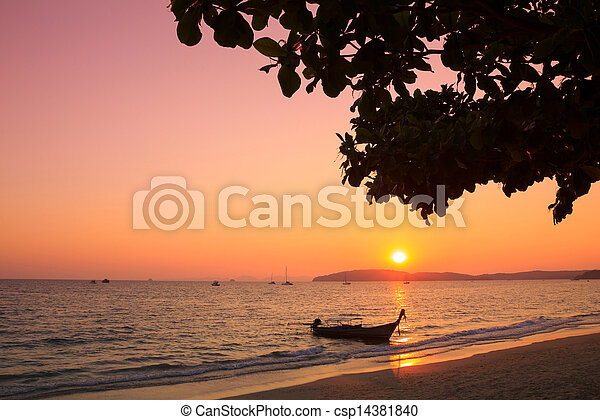 Longtail boat in Andaman sea at sunset, Thailand - csp14381840