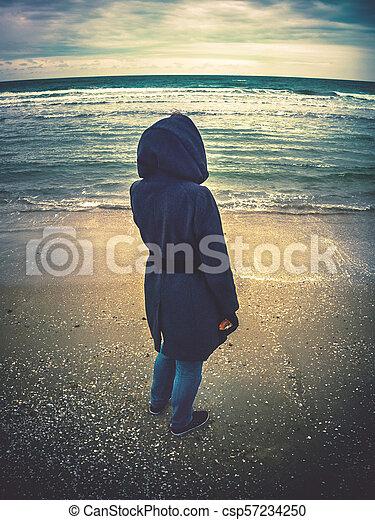 looking at the winter sea - csp57234250