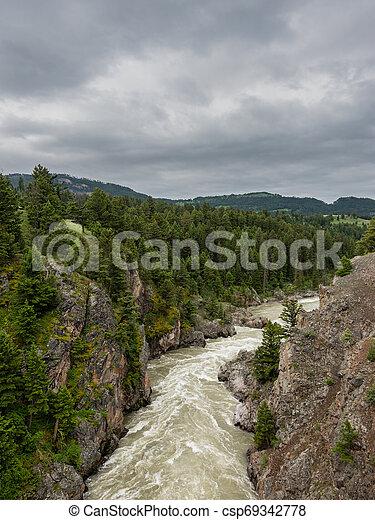 Looking Down Hellroaring Creek - csp69342778
