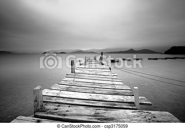 Looking over a pier and boats, black and white - csp3175059