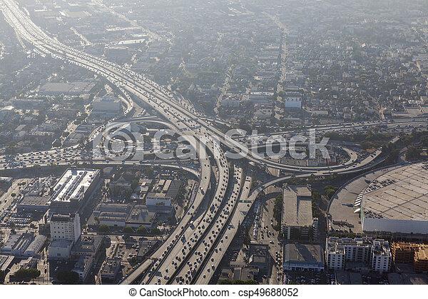 Los Angeles Downtown Freeways Summer Smog Aerial - csp49688052