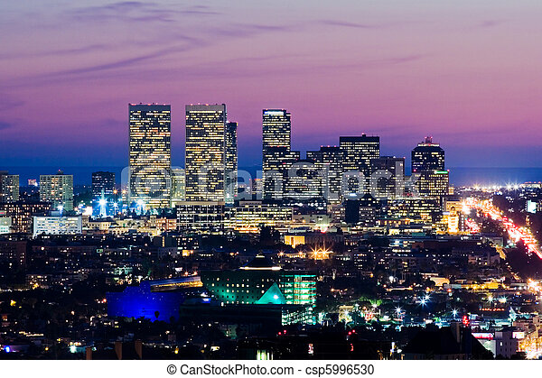Los Angeles skyline at dusk. View of Century City and Pacific Ocean. - csp5996530
