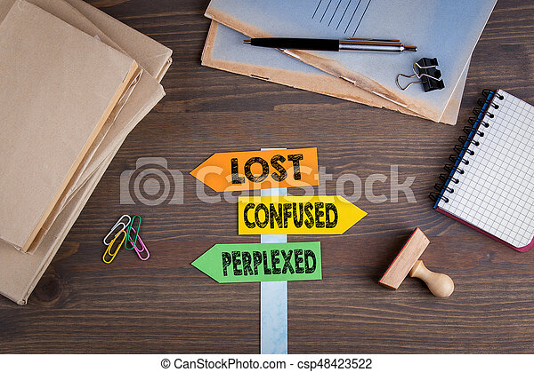 Lost, confused and perplexed concept. Paper signpost on a wooden desk - csp48423522