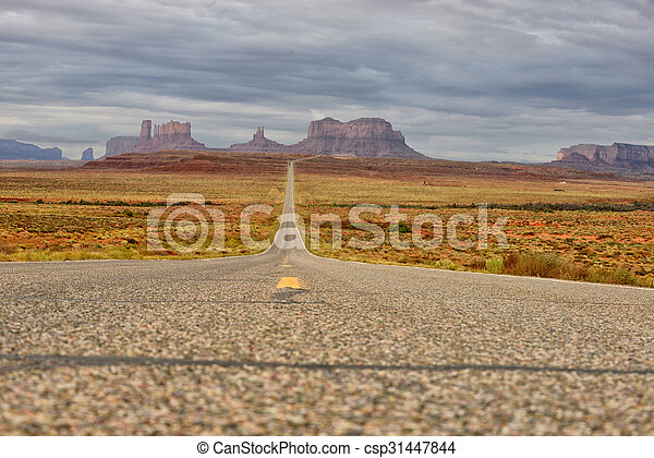 Lost on an empty road in Monument Valley - csp31447844