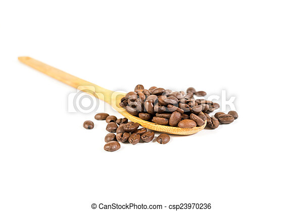 Lots of coffee beans. Closeup. Wooden spoon. Isolated. - csp23970236