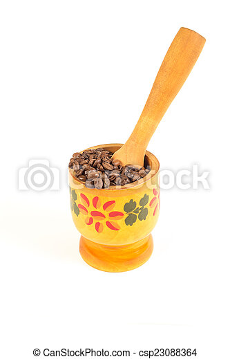 Lots of coffee beans in the wooden mortar - csp23088364