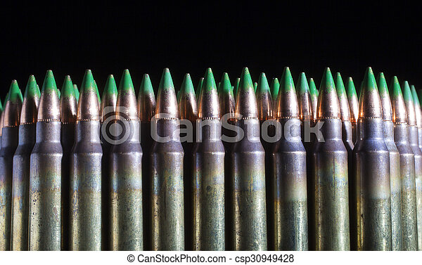 lots of green tipped ammunition rifle cartridges with a green tip